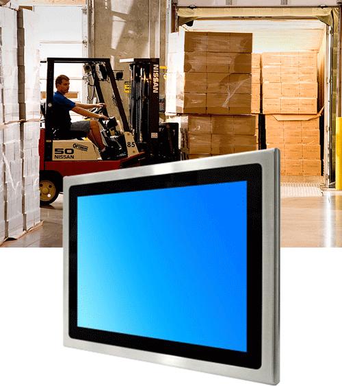 En truck på et lager og en skjerm ved siden av